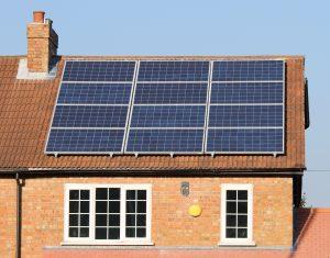 Solar photovoltaic panel array on a tiled house roof